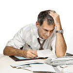 man-paying-bills-worrying-11783020